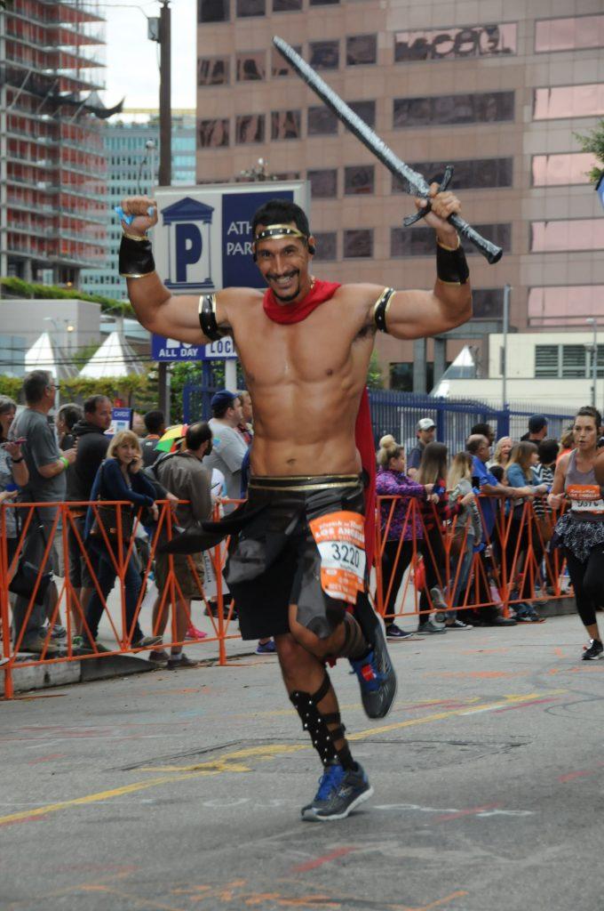 John running the half-marathon dressed as a spartan and self-confident
